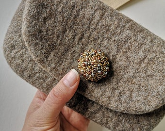 Felt phone purse with wrist handle and glass beaded button. Elegant felted wool purse in natural colour. Custom colour available. Made in UK