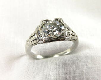 Spring Sale.  Circa 1950's Engagement Ring set with a 1.20 CT Old European Cut Diamond in 18KT White Gold