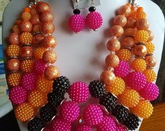 Four Strand Orandge and Raspberry Bead Necklace