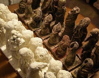 Weird Horror Chess Set in Hues of Mottled Flesh and Ivory
