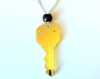 "Latch Key Kid Necklace, Sterling Silver 15"" choker-length chain, Pop Art inspired die cut gold mirror plexi oversized house key"