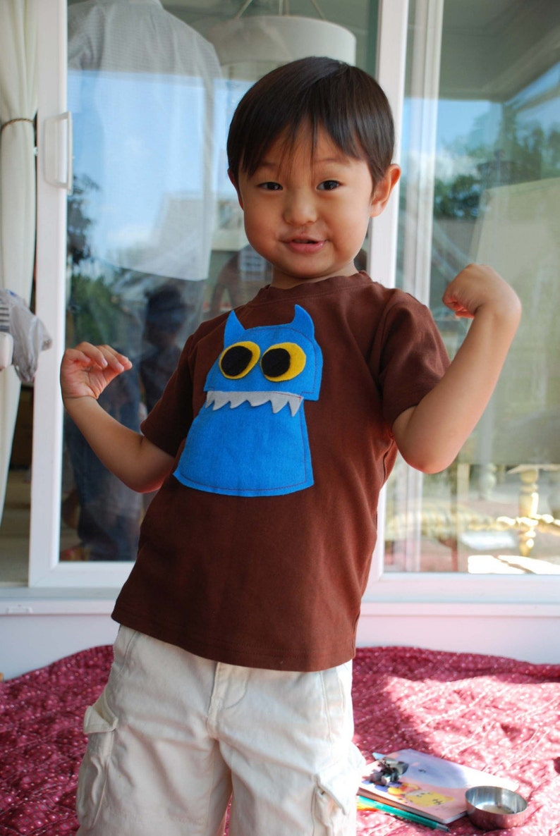 Short Sleeved Brown T-shirt with Blue Coop the Monster image 0