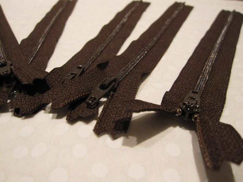 Eight dark brown zippers that are 8 long sewing purse making