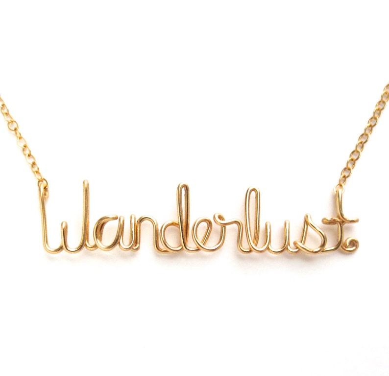 Wanderlust Necklace. Gold Wanderlust Necklace. image 0