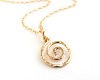 Gold sun swirl pendant. Gold spiral necklace pendant.