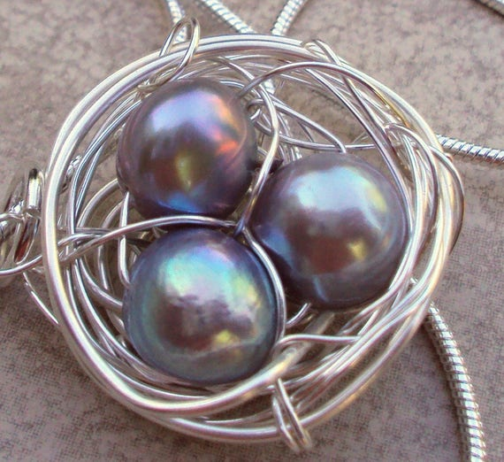 Handcrafted Birds Nest Necklace Large Birdsnest with natural soft blues of egg stones
