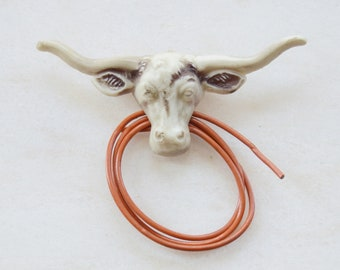40s/50s Plastic Bull and Robe Brooch