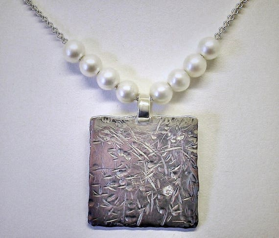 Sterling, Pearl, and Diamond Pendant