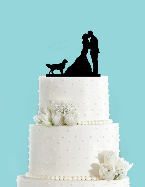 Wedding cake topper.  Silhouette of a couple kissing and a Golden Retriever.