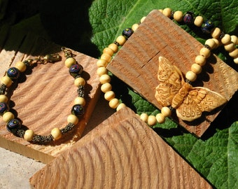 Antiqued Bone Butterfly and Flowers Asymmetrical Necklace and Bracelet Set