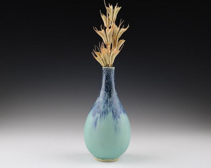 Carved bottle vase in aqua and navy blue
