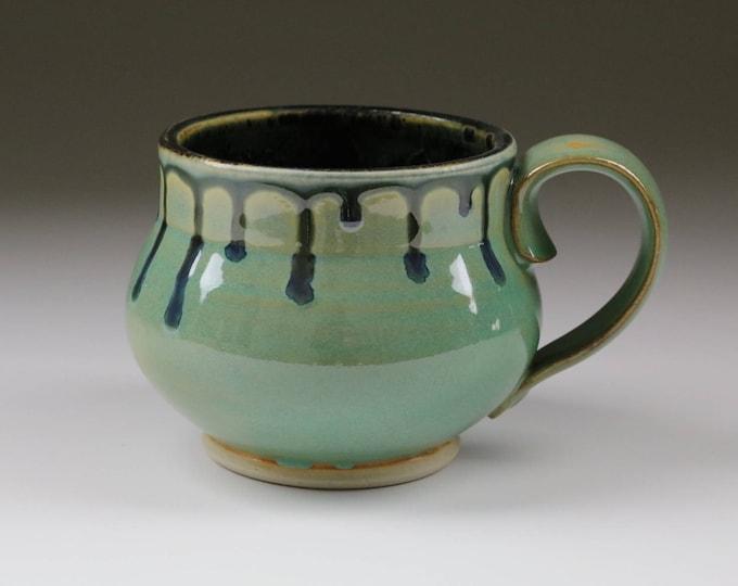 Wheel-thrown stoneware pottery coffee or tea mug in aqua with dripping glaze