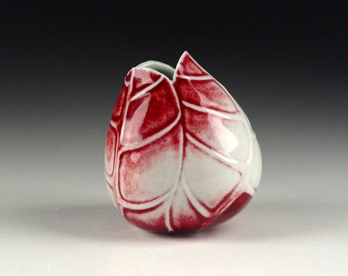 Tilted red porcelain ceramic pottery bud vase
