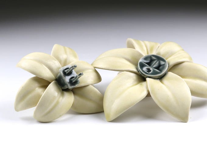 Pair of porcelain Flower Power wall sculptures with outlet and plug in pale yellow and gray