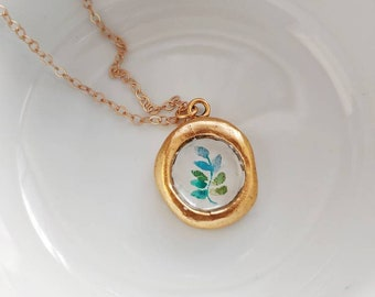 Hand painted eucalyptus wax seal necklace.