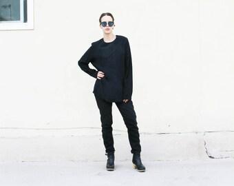 Long sleeved black silk blouse. M