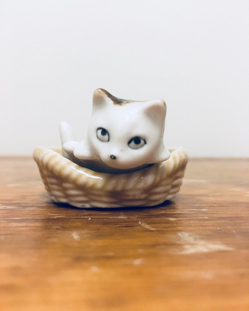 358063df2d Small Porcelain Cat Curled Up in Basket