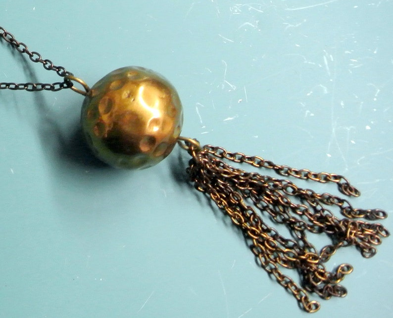 Rare vintage 1950s adjustable round handworked goldcolor brass bead pendant necklace with copper chain and tuft