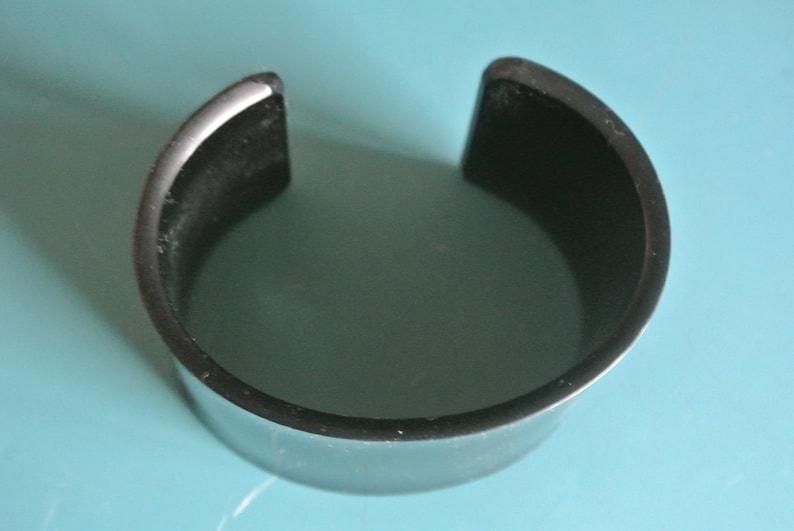 Unusual vintage 1980s wide black lucite plastic bangle bracelet with opening