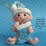 Babys First Christmas 2nd Christmas Personalized ornament baby boy blue or baby girl pink holding Christmas Stocking with gift box
