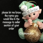 Baby's First Christmas Ornament Green for baby boy or baby girl  Elf Ornament, Green Elf Ornament holding gold glitter ornament