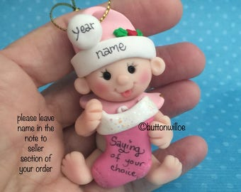 Babys 2nd Christmas, First Christmas Personalized ornament  baby girl pink holding Christmas Stocking with gift box