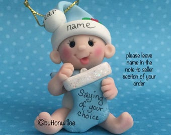 Babys First Christmas 2nd Christmas Personalized ornament baby boy blue holding Christmas Stocking with gift box
