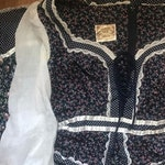 RESERVED- 1970's vintage Gunne Sax peplum dress