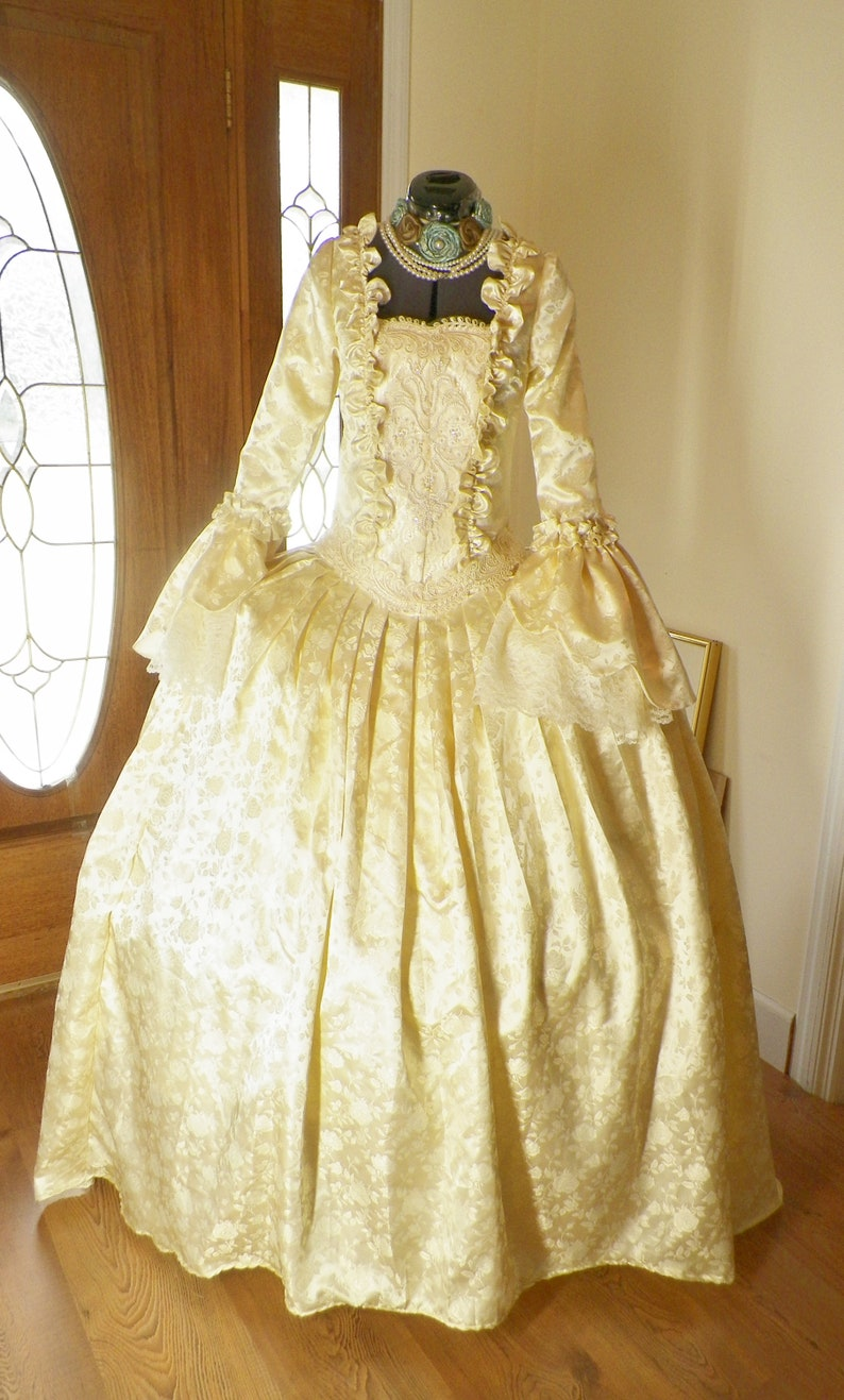 Masquerade Ball Clothing: Masks, Gowns, Tuxedos Marie Antoinette Dress Marie Antoinette Costume Masquerade Ball Gown Venice Mardi Gras Panniers Costume Ivory Dress handmade $498.00 AT vintagedancer.com