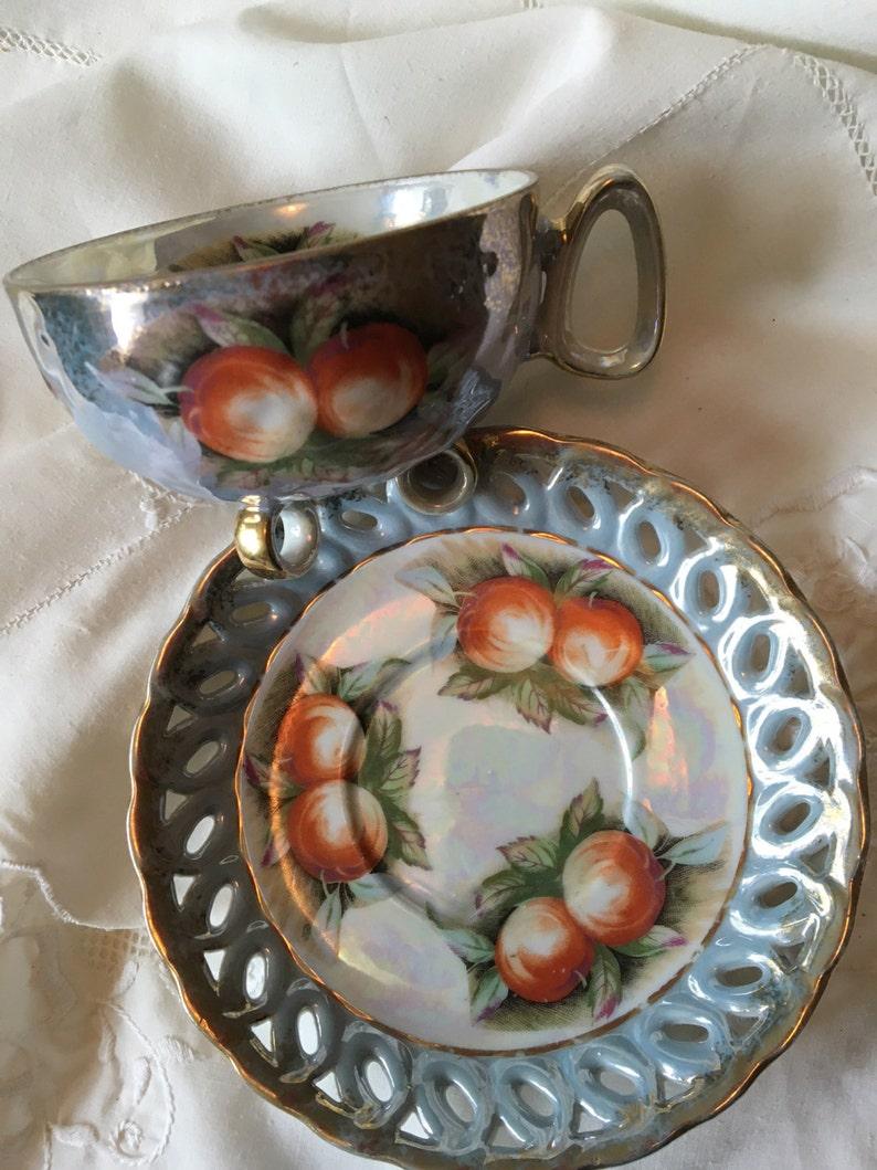 Teacup/saucer lustreware teacup/saucer set cutout saucer image 0