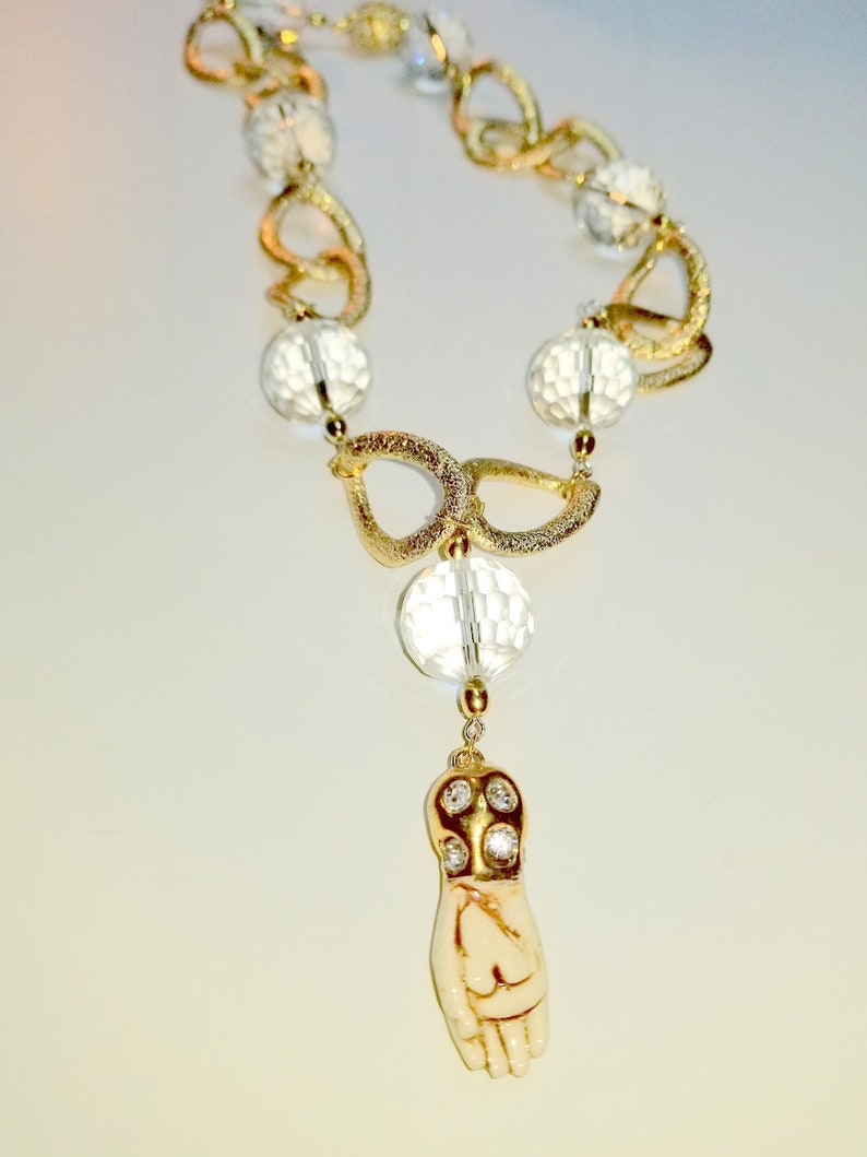 Faceted Rock Crystal Quartz on a Gold Tone Necklace