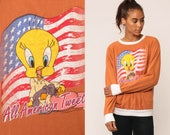 Tweety Bird Shirt Looney Tunes Sweatshirt ALL AMERICAN TWEETY 90s Cartoon Top Graphic Raglan Retro 1990s Vintage Rust Slouchy Small