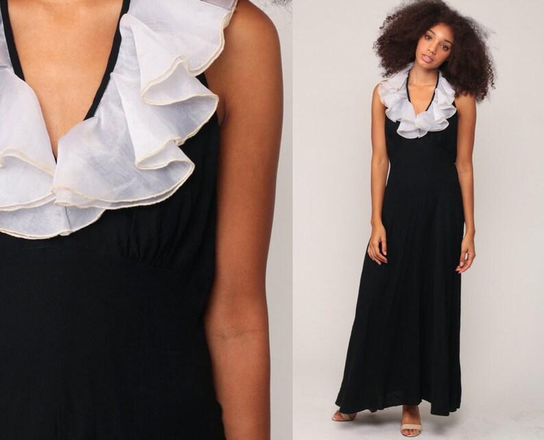 eadef3a6e12 Maxi robe noire des années 70 Halter cou partie blanche à