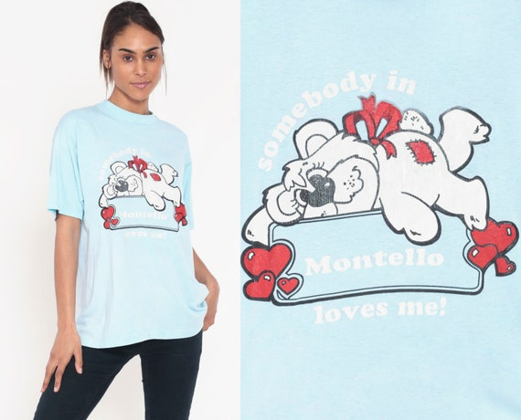 Wisconsin T Shirt SOMEBODY in Montello LOVES ME Vintage Hipster Teddy Bear Baby Blue Shirt 1980s Retro Tee Kawaii Gift Shirt Extra Large xl