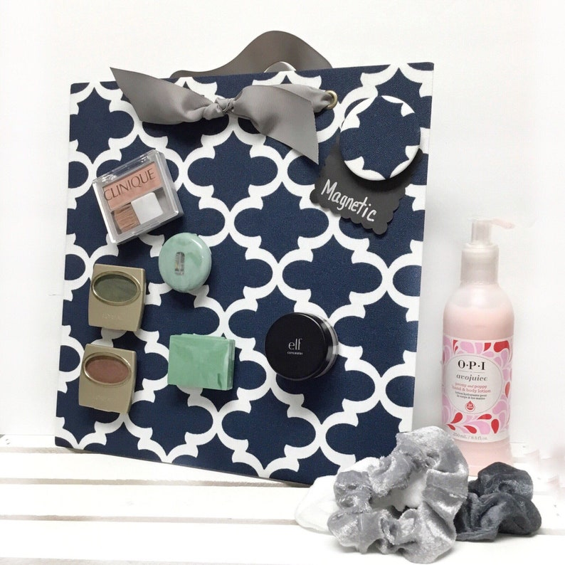 Having a magnetic makeup board can save you so much space. Get the most out of your tiny dorm room space with 14 items that promise better dorm room organization.