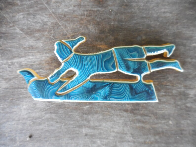 Vintage Unsigned Laminated Celluloid Pin Brooch Sled Sledding Toboggan
