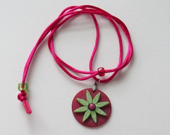 Light green Flower on a Deep Pink Disc Adjustable Cord Necklace SKU: NK1037