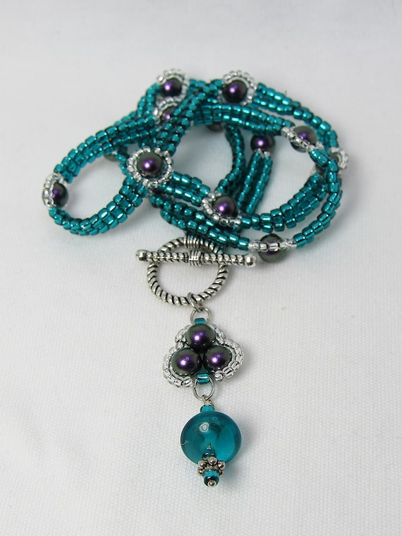 Teal and Purple Front Hooking Beaded Necklace with Drop Pendant SKU: NK1040