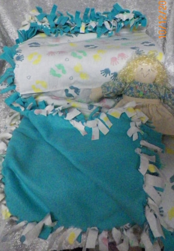 Hand Tied Flannel Baby Blanket with Multi Colored Hand and Foot Prints
