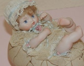 Porcelain Baby on an Egg Trinket Box