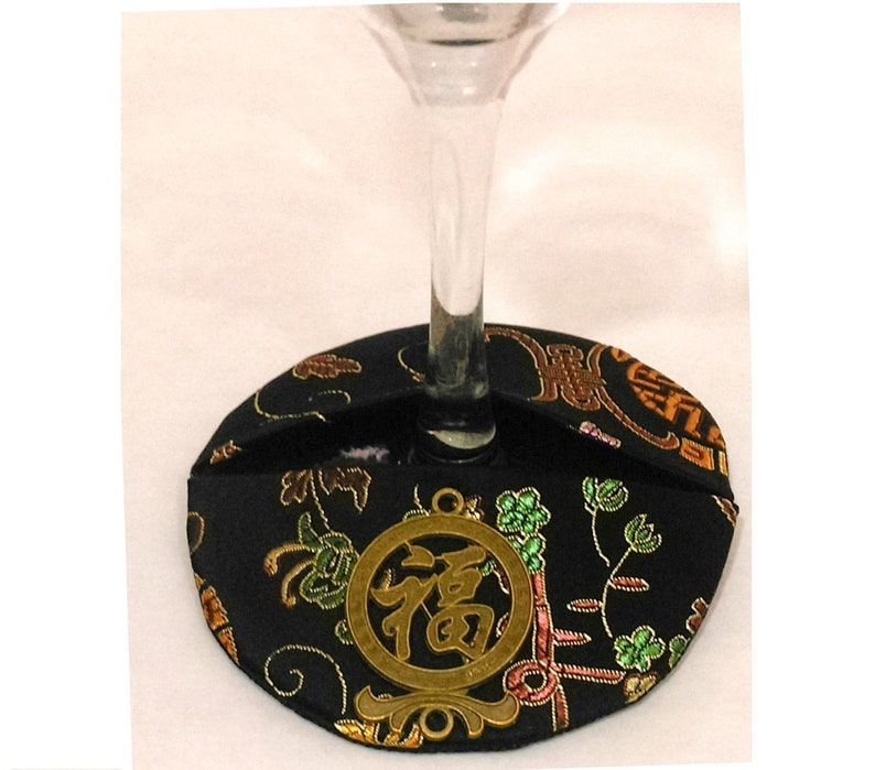 Black Asian brocade stemware coaster and identifier.  With image 0