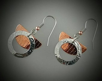Copper and aluminum drop,dangle,some,circle earrings. Surgical steel french hook hypo-allergenic ear wires. Hand crafted.