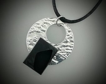 Black onyx and aluminum pendant on 18 inch satin cord. Statement peice. 18x25 mm black onus rectangular cabochon. Very contemporary.