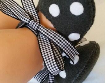 Dark grey with white polka dots
