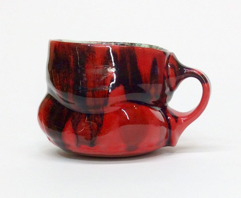 cdd8646b09be red mug with black and iron glaze