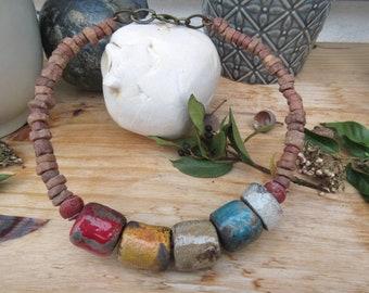 "A rustic and primitive ethnic necklace with raku handmade ceramics: ""Funanbules De l'Aube"" ...."