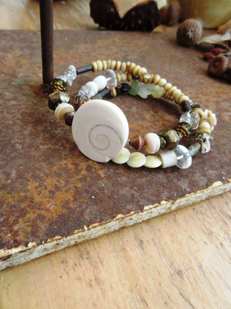 A nature adornment memory bracelet and earrings with pearls eye of St Rhythms Of The Oceans.... Lucia