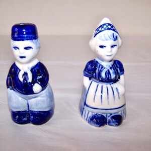 Paint rubbed off in places Chef salt and pepper shakers see pics. vintage Sunshine Crackers bakers salt and pepper set