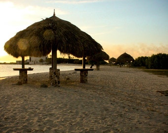 Photograph of Tropical Caribbean Grassy Straw Tiki Beach Hut on the Sandy Aruba Sunset Sky Coastal Nautical Home Decor Vertical Art Print
