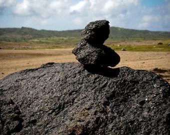 Photograph of Stacked Gray Black Rocks in Sandy Arid Aruba Terrain with Blue Caribbean Island Sky Vertical Travel Art Print Home Decor